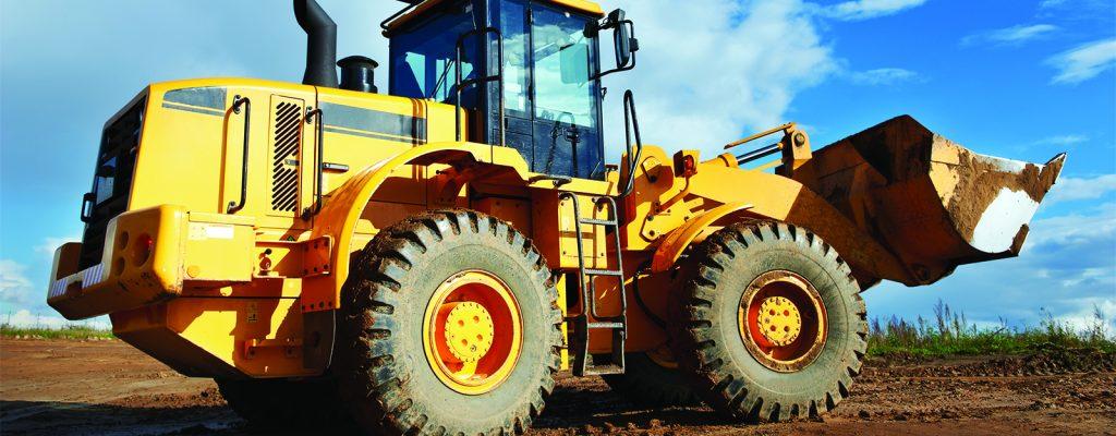 Photo of a yellow bulldozer.