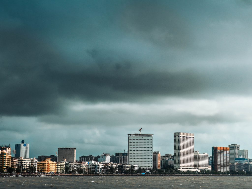 Photo of a cityscape with dark grey stormy skies.