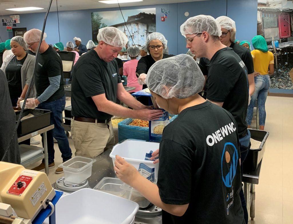 Photo of volunteers prepping food.