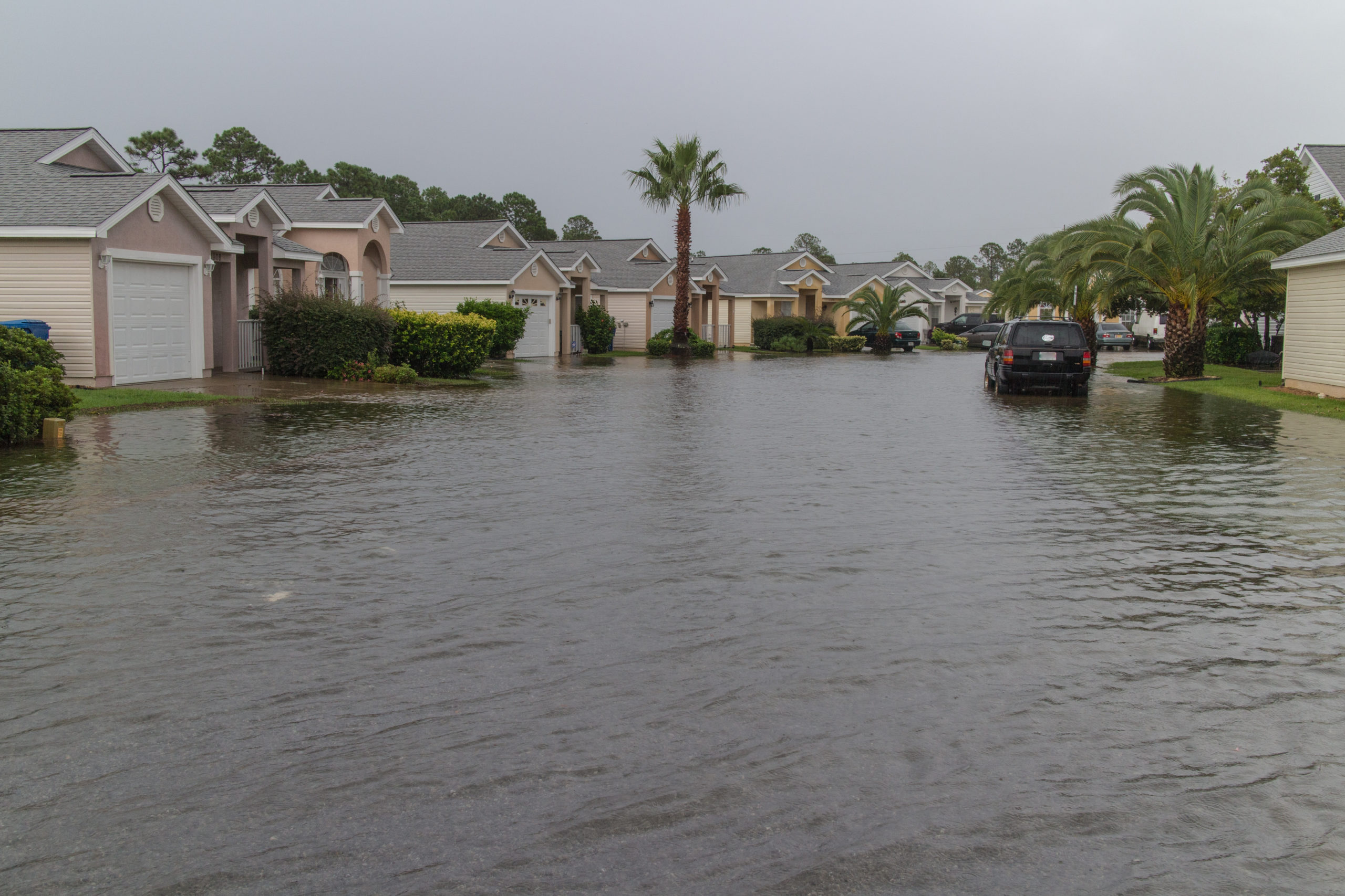 Photo of a flooded residential street in Florida.